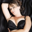 Lingerie and black sheets - Stock Photo