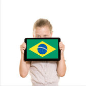 Brazillian flag on tablet computer — Stock Photo