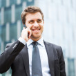 Businessman talking on the phone - Foto Stock