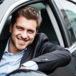 Handsome man driving his car — Stock Photo #22618163