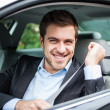 Portrait of an handsome man on his car — Stock Photo #22618237