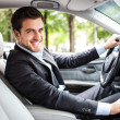 Stock Photo: Handsome man driving his car