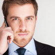 Handsome businessman talking on the phone — Stock Photo