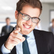 Stock Photo: Businessman pointing his finger at you