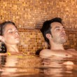 Stock Photo: Couple relaxing in a spa