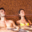 Couple relaxing in a spa - Stock Photo