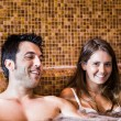 Stock Photo: Young couple relaxing in a spa