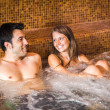 Couple doing a whirlpool bath in a spa — Stock Photo