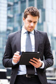 Businessman using a tablet — Stock Photo