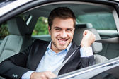Portrait of an handsome man on his car — Stock Photo