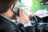 Man talking on the phone on his car — Stock Photo