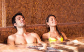 Couple relaxing in a spa — Stok fotoğraf