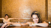 Young couple relaxing in a spa — Stock Photo