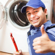 Stock Photo: Technician repairing a washing machine