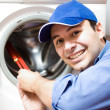 Technician repairing a washing machine — Stock Photo #22620517