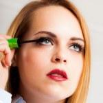 Woman applying mascara — Stock Photo #22621857