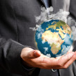 Businessman holding the world in his hand - Stock Photo