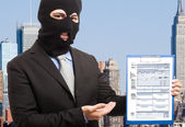 Thief showing a document — Stock Photo