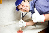 Smiling plumber at work — Stock Photo