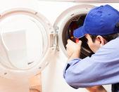 Washing machine repair — Stock Photo