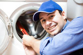 Technician repairing a washing machine — Stock Photo