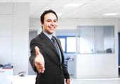 Smiling businessman shaking hands — Stock Photo