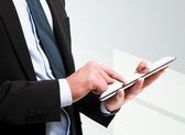 Closeup of a man holding a tablet pc — Stock Photo