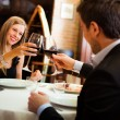 Couple having dinner in a restaurant - Stock Photo