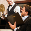 Waiter serving dinner — Stock Photo