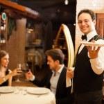Waiter serving dinner — Stock Photo