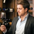 Man tasting a glass of red wine - Foto de Stock