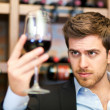 Stock Photo: Sommelier looking to wine glass