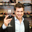 Sommelier looking to a wine glass - Stock Photo