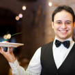 Waiter holding a plate — Stock Photo