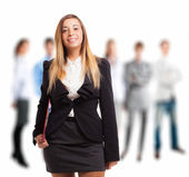 Businesswoman in front of her team — Stock Photo