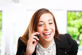 Happy woman talking on the phone — Stock Photo