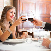Dinner in an italian restaurant — Stock Photo