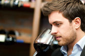 Sommelier looking to a wine glass — Stock Photo