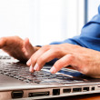 Businessman working at his laptop — Stock Photo #23282700
