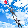 Stock Photo: Businessmen flying in the sky