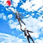 Бизнесмены, летать в небе — Стоковое фото