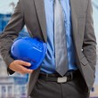 Architect holding his helmet — Stock Photo