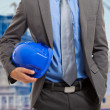 Architect holding his helmet — Stock Photo #23282722