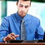 Businessman using a calculator — Stock Photo #23282936
