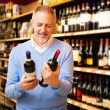Man choosing wine - Stock Photo