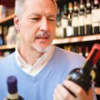 Man comparing two wines — Stock Photo