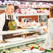 Shopkeeper serving a customer — Stock Photo #23283896