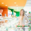 Woman shopping in a supermarket — Stock Photo #23283936