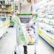 Woman shopping in a supermarket — Stock Photo #23284014