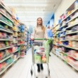 Woman shopping in a supermarket — Stock Photo #23284142